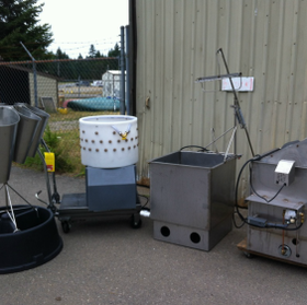 poultry processing equipment next to a grey shed