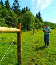 Technician checking fence